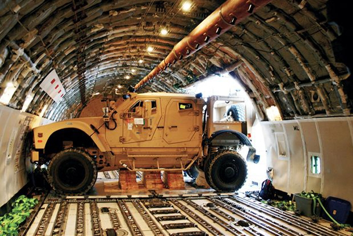 1007_11+oshkosh_m-atv_military_vehicle+squeezing_through_side_cargo_door.jpg